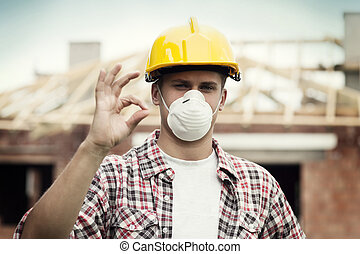 Manual worker with hard hat and protective mask