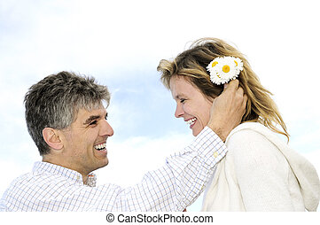Mature romantic couple with flowers - Mature couple enjoying...