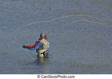 Fly Fisherman Fishing - Fisherman in the river with a fly...