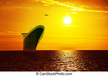 Ship on sunrise sea