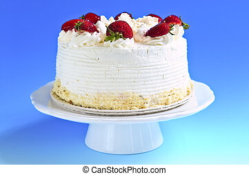 Strawberry meringue cake on a plate on blue background
