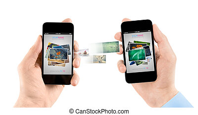Mobile smart phones while transferring pictures - Two hands...