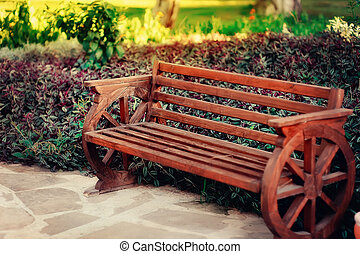 wooden bench - Beautiful wooden bench is in a park on the...