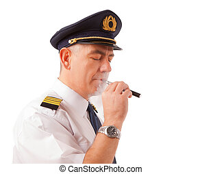 Airline pilot with cigarette - Airline pilot wearing uniform...