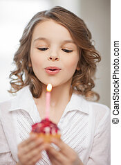 girl with cupcake - picture of beautiful pre-teen girl with...