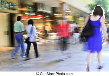 Shopping in a mall - People shopping in a mall, panning...
