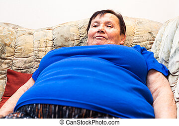 Obese elderly woman smiling