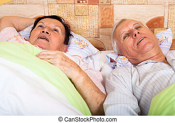 Senior couple resting in bed - Close up of happy senior...