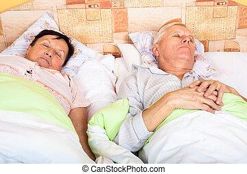 Senior man and woman sleeping - Close up of senior man and...