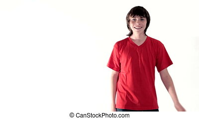 Teen boy dancing making face - Cheerful teenage boy dancing,...