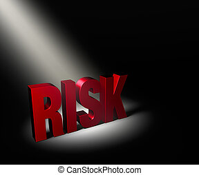 Revealing Risk - Angled spotlight revealing red Risk on a...