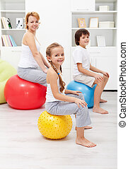 Happy family exercising at home - Happy family - woman and...