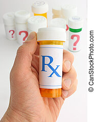 Choosing The Right Medicine - A hand holding a medicine...
