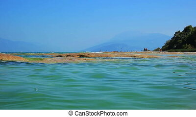 Garda lake water. - Garda lake water close-up.