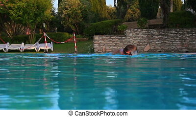 Young man swimming. - Young man swimming in pool.