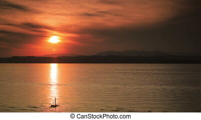 Sunset over Garda lake. Fast motion effect.