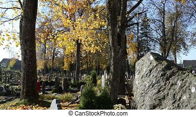 kid child cemetery autumn - kid child in red walk in old...