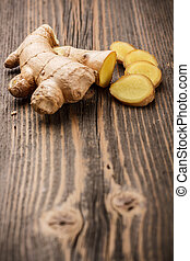 Ginger root - Sliced ginger root on rustic wooden background