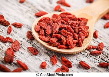 Goji berries - Red dried goji berries in wooden spoon