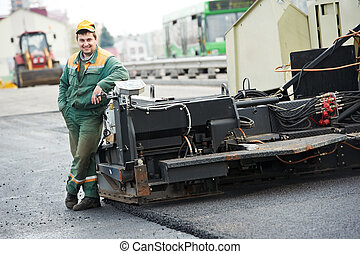 asphalt road worker - happy road construction worker near...