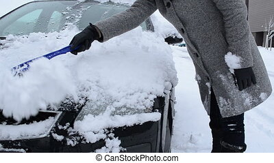 car snow remove woman - woman clean remove snow from car...