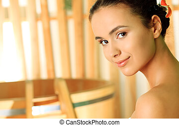 clear skin - Beautiful young woman taking spa treatments at...