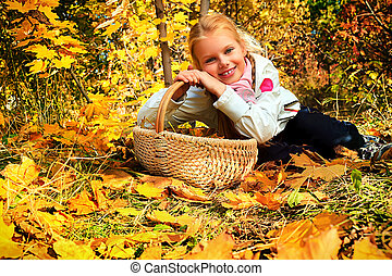 relaxing girl - Portrait of a cute girl with a basket full...