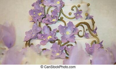 Wedding cake - Beautiful wedding cake decorated with violet...