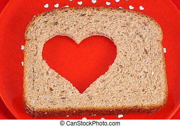 Heart Healthy Bread - Slice of whole wheat bread with heart...
