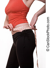 Measure waist - Body of a slim woman in red sports top and...