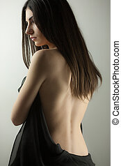 Gorgeous brunette portrait with naked back Shallow depth of...