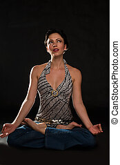 Meditating over black - Full body of young short hair woman...