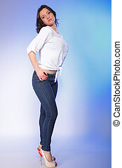 stylish young plus size model in fashion jeans