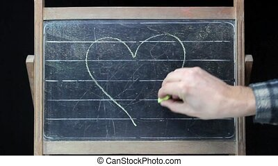 Heart and arrow - romantic drawing on chalkboard, heart...