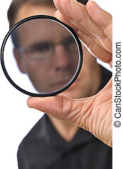 Filter inspection - Closeup of photographer man holding and...