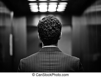 Back of man - Rear view of young man in suit, black and...