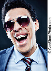 Lucky - Portrait of shouting man in sunglasses and dental...