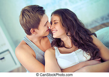 Sweet embrace - Handsome guy embracing his girlfriend at...