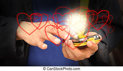 Hand of business man send heart on mobile phone as Valentine...