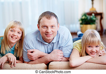 Man with daughters - Portrait of happy man with twin...