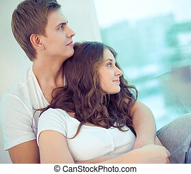 Devotion - Portrait of amorous young couple enjoying rest