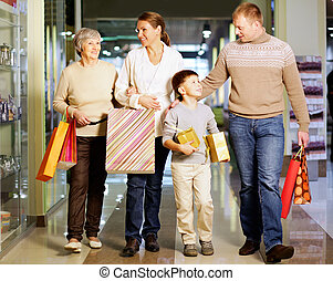 Family shopping - Portrait of happy family during shopping...