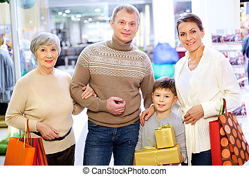 Good shopping - Portrait of happy family during shopping in...