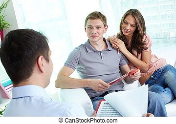 Discussing insurance program - Manager and young couple...