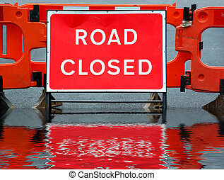 Road closed sign - Temporary barricade across a road closed...