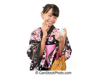 Cute girl wearing yukata