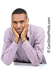 African american male college student sitting at desk