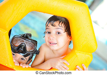 Two brothers in pool playing