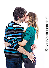 Happy couple kissing - Happy young couple kissing each other...