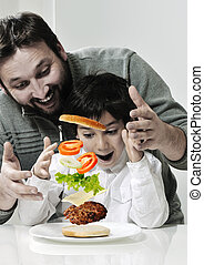 Retro photo of dad and son making hamburger